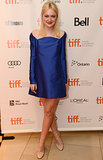 Dakota Fanning ditched the denim and looked fabulous in an electric blue off-the-shoulder minidress at the Toronto premiere of The Last of Robin Hood.