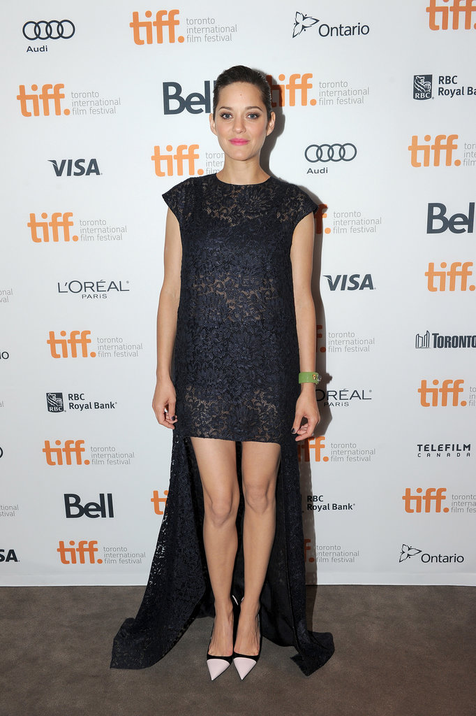 Marion Cotillard continued her affair with the house of Dior in a lace high-low gown at the Blood Ties premiere.