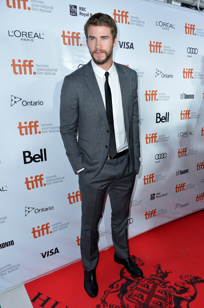 Liam Hemsworth arrived solo before joining his brothers on the red carpet.