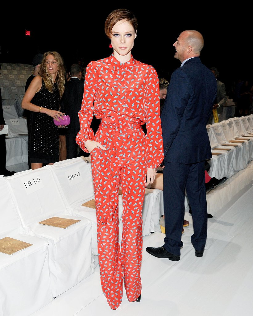 Coco Rocha readied to take her seat at the DVF runway show in printed separates.