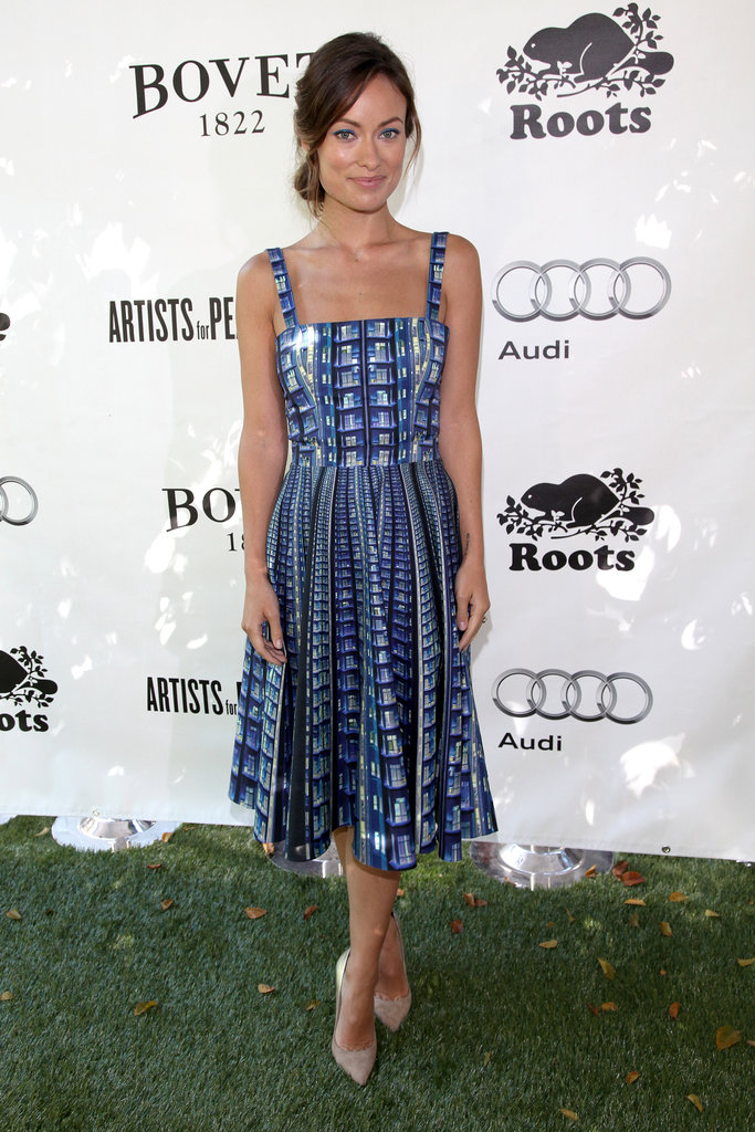 """Olivia Wilde attended the Artists For Peace and Justice brunch at the Toronto Film Festival wearing a Resort 2014 """"Suddenly"""" dress by Mary Katrantzou."""