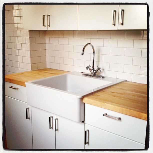 Butcher block, white subway tile, and white cabinets keep it clean and classic. Source: Instagram user designsponge