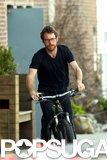 Michelle Williams's boyfriend, Dustin Yellin, rode his bike around the neighborhood.