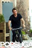 Michelle Williams's boyfriend, Dustin Yellin, rode his bike around the neighborhood.