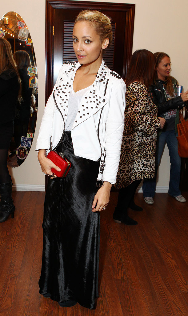 Nicole put a rocker spin on black and white, topping her textured maxi with a studded Simone leather jacket and adding a fiery House of Harlow 1960 clutch at an LA pop-up shop in November 2011.