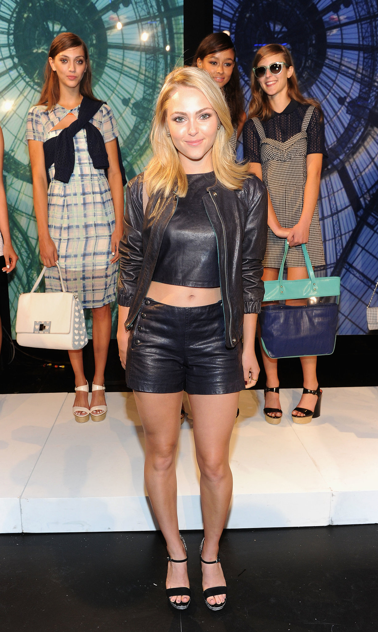 AnnaSophia Robb showed off her midriff in a leather ensemble at Charlotte Ronson's presentation, then finished with Jean-Michel Cazabat sandals.