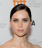 Felicity Jones played up her eyes with navy shadow in a cat-eye shape at The Invisible Woman premiere.
