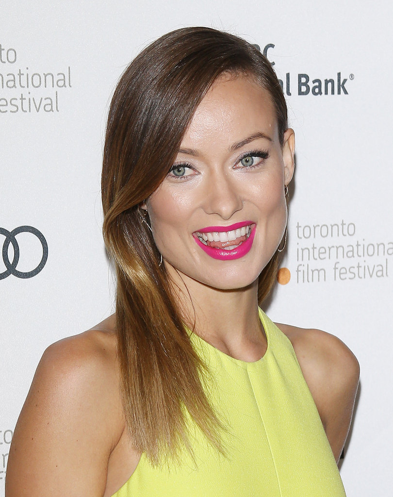 Also at the Third Person premiere, Olivia Wilde went for contrast with hot pink lips, which were balanced with a sleek blowout.