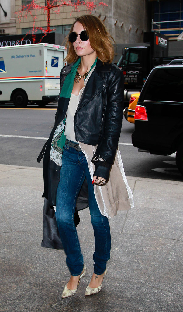 Nicole's March 2013 Big Apple look was a triple (layered) threat. The designer bundled up in a colorblock handkerchief blouse, neutral velour coat, and trendy leather moto.