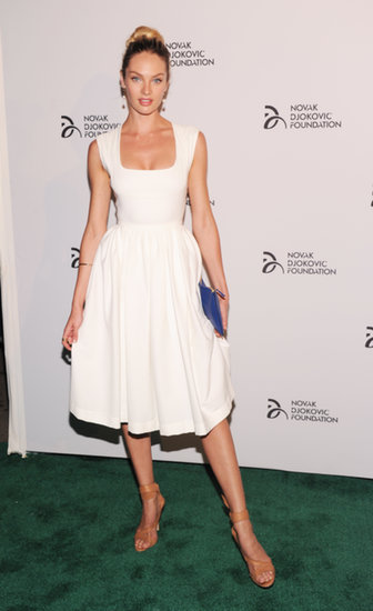 Candice Swanepoel wore a white dress to Novak Djokovic's dinner in NYC.