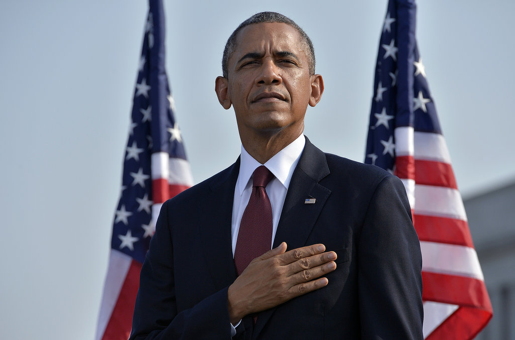 President Obama stood with his hand on his heart during the moment of silence at the White House in DC.