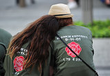Two people honoring the life of firefighter Frankie Esposito stayed close during the ceremonies at the 9/11 Memorial in NYC.