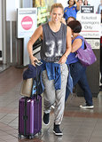 Bar Refaeli kept it sporty in a muscle tee, sweatpants, and high-top sneakers at LAX.