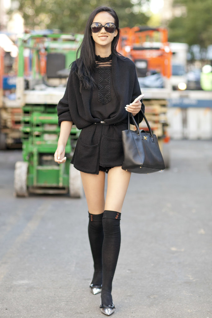 All black is hardly boring when you add knee-high socks.