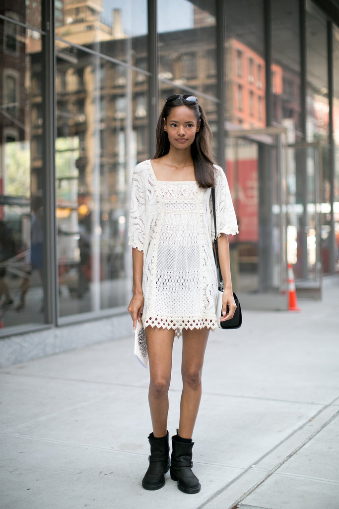 The secret to styling a sweet lace dress is tough-girl biker boots for contrast.