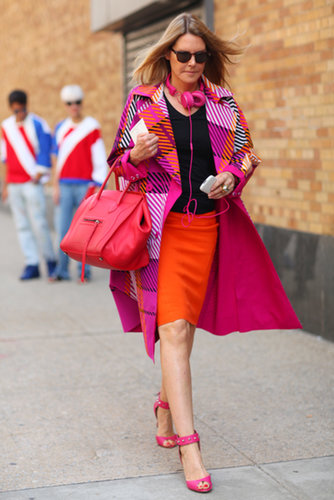 We can't get enough of her bright look — this showgoer embraced a bold colorwheel, even on her Céline tote.