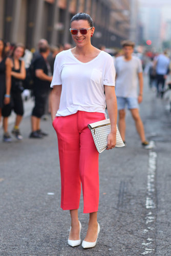 Garance Dore styled up a white t-shirt with red trousers and chic pumps.