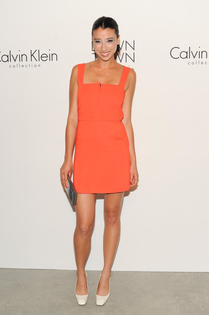 Lily Kwong brightened up the room in Calvin Klein Collection's orange at the Spring Studios afterparty for the label's runway show.