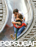 Miranda Kerr cuddled Flynn while taking a ride on the slide at a NYC playground.