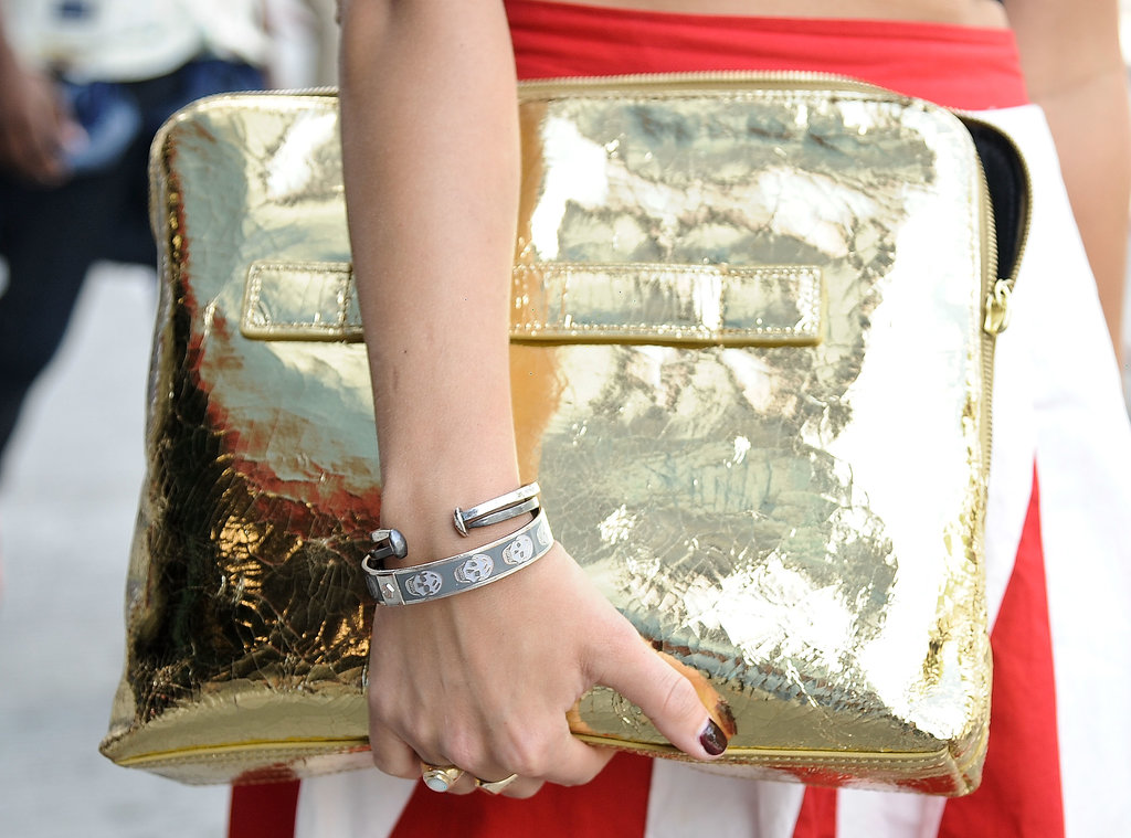 You can't go wrong with a metallic in the form of a clutch or a computer case.