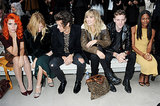 Harry Styles chatted with Sienna Miller, Paloma Faith, and Suki Waterhouse before the Burberry Prorsum show at London Fashion Week.