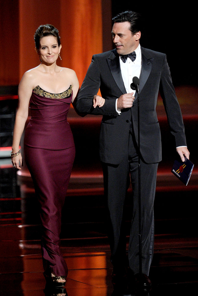 Tina Fey was escorted on stage by Jon Hamm in 2012.