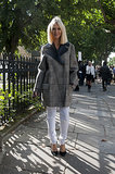 Zanna Roberts Rassi took her white jeans right into Fall with a checked coat.
