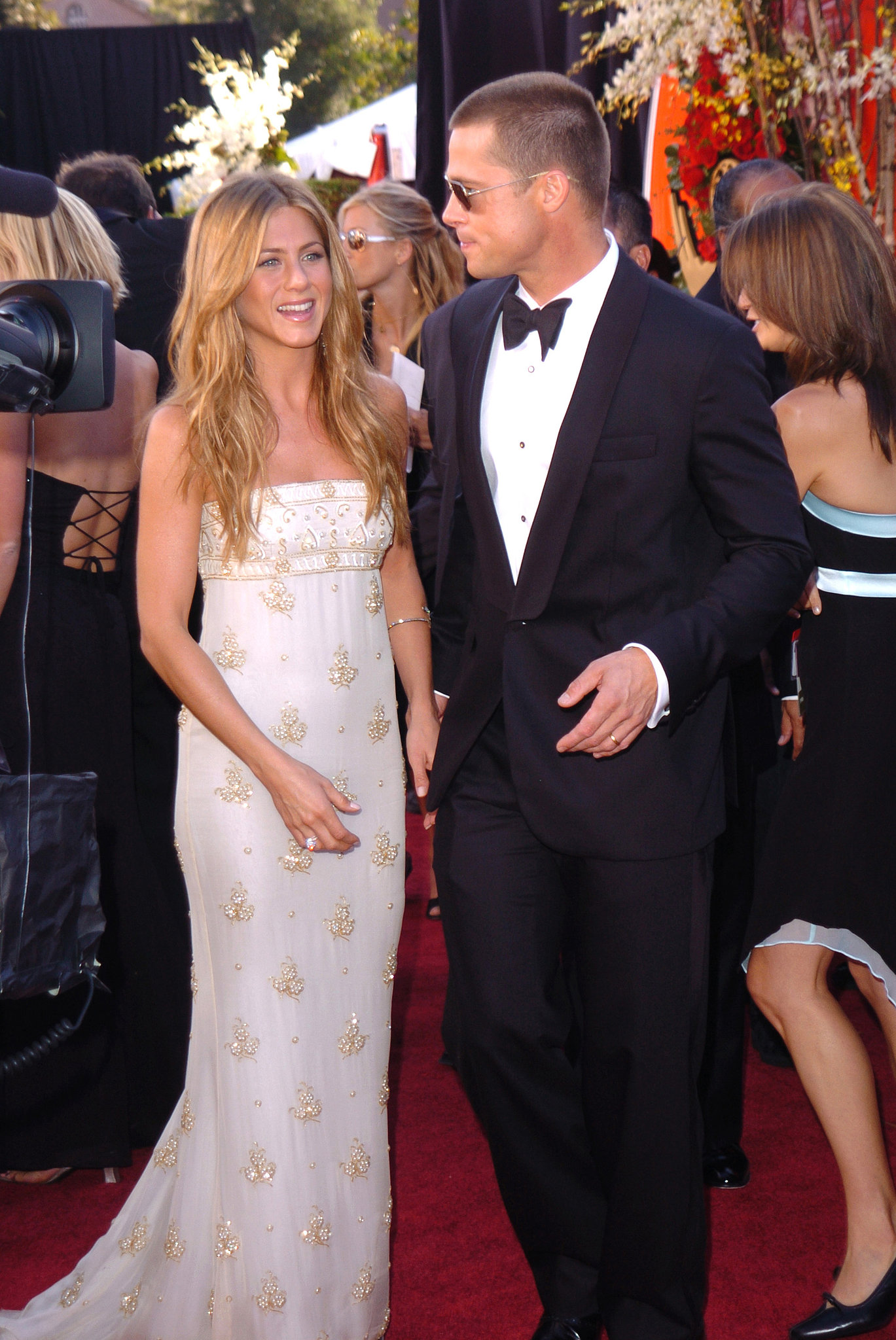 Jennifer Aniston wore a lovely white and gold gown to the festivities in 2004.