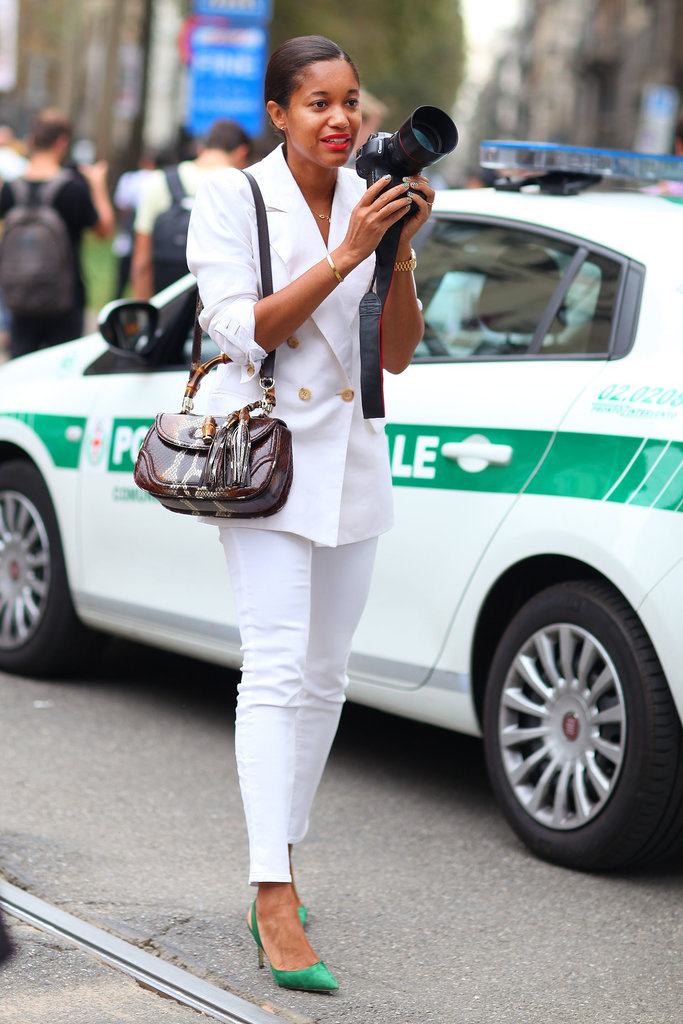 It doesn't get any more chic than a white suit and a red lip.