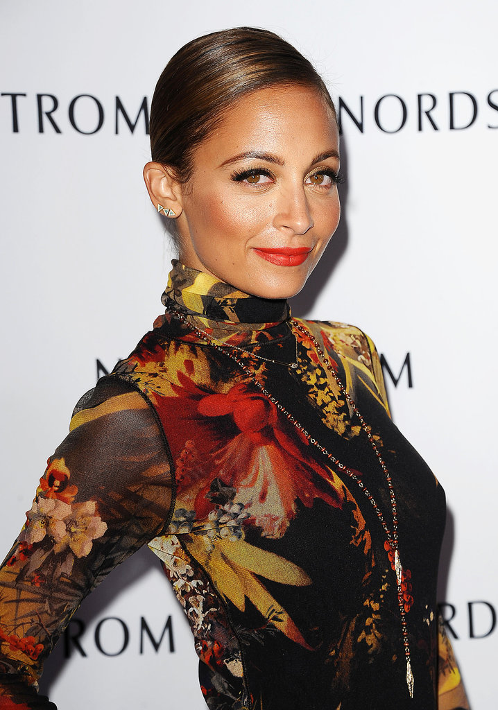 Everything about Nicole Richie's look she wore at a Nordstrom gala earlier this week screams Fall. She translated the seasonal color palette to glowing, bronzed skin, which she completed with gold eye shadow and rich orange lipstick.