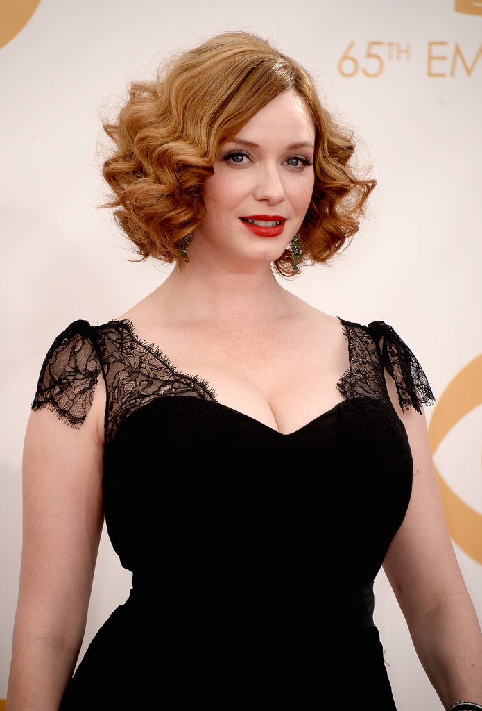Christina Hendricks played up her amazing haircut with two-textured curls, finishing off her Emmys look with a classic red lip.