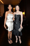 Clad in a pearl gray Salvatore Ferragamo dress and navy heels, Freida Pinto posed with Andrea Riseborough (in Pamella Roland) at the Bulgari accessories collection launch in Milan.