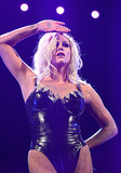 Ke$ha showed off multiple tattoos and a platinum blond mane as she performed at the iHeartRadio Music Festival.