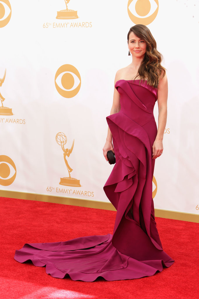 Ruffles ruled the night for Linda Cardellini, who picked a dramatic magenta Donna Karan Atelier gown. The dramatic look was finished off with Jimmy Choo shoes, Irene Neuwirth jewels, and a Rauwolf bag.