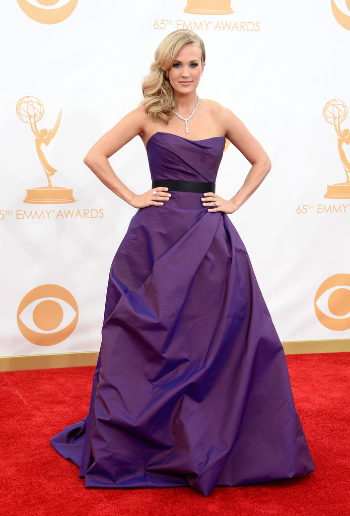 Carrie Underwood arrived wearing a strapless Ramon Keveza dress, Jimmy Choo shoes, and Johnathon Arndt jewels.