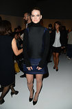 Alice Eve covered up in a black and navy long-sleeved dress at the Salvatore Ferragamo Spring 2014 show but showed a little skin via her legs.