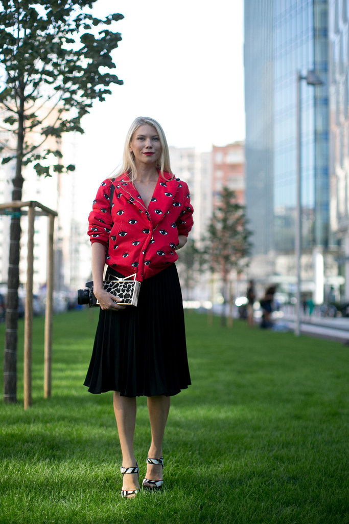 Who knew how well eye print and animal print paired together? While at Milan Fashion Week, this showgoer embraced the bold print on a bold colored top.