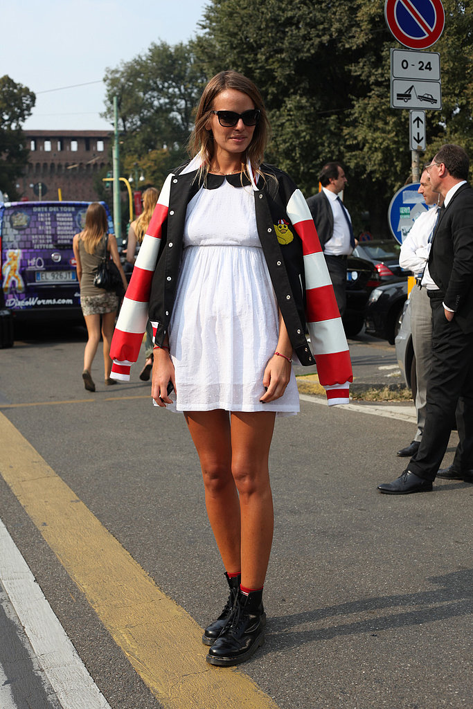 A baby-doll dress, dolled up with a varsity jacket and combat boots.