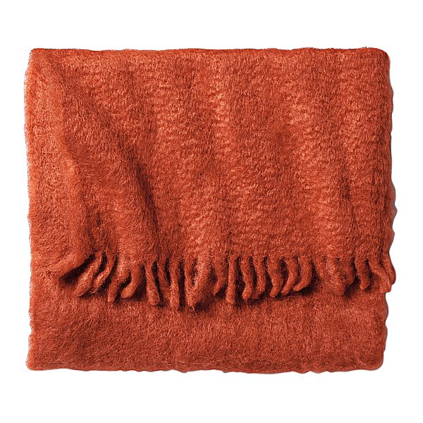 Made by hand in a Spanish mill, this brightly colored throw ($250) is made from 100 percent hand-combed mohair.