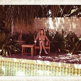 Beyoncé relaxed by the pool in a gold bikini. Source: Instagram user beyonce