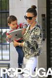 Miranda Kerr held onto her son, Flynn, as he played with an iPad in NYC on Wednesday.