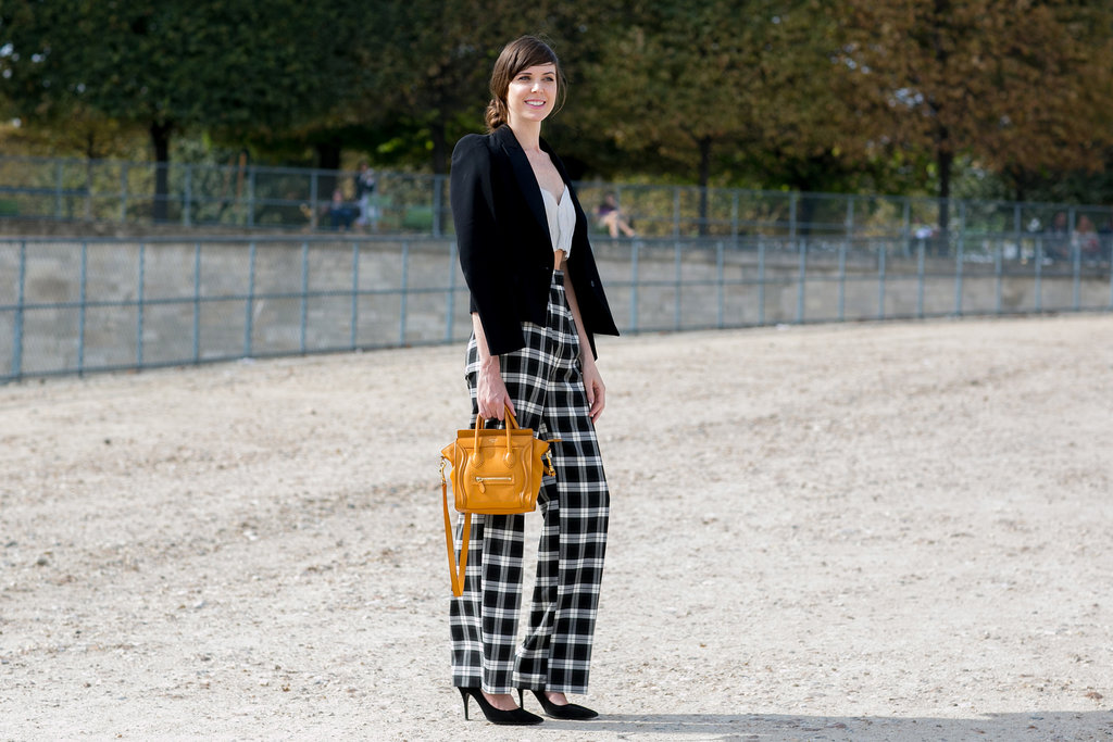 One way to make a black and white look pop: a bright pop of color on your arm candy.
