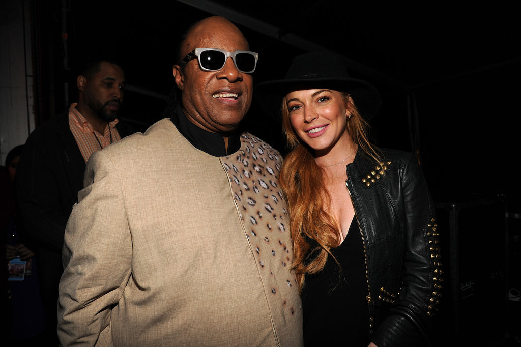 Stevie Wonder chatted with Lindsay Lohan backstage.