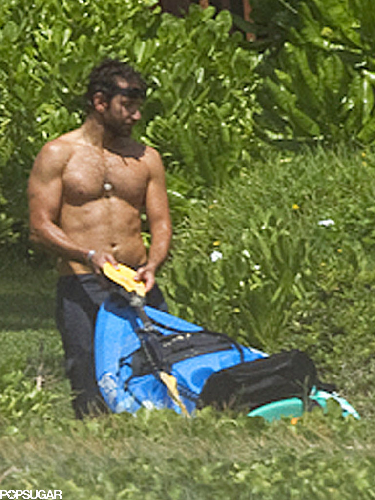 Bradley Cooper put his muscles to work at the beach.