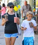 Reese Witherspoon held onto two smoothies while carrying an Honest Company tote.
