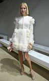 Elena Perminova softened things up in an airy white design at the Giambattista Valli Paris Fashion Week show.