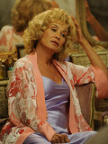Constance Langdon  What to wear: A lavender negligee, pink floral silk robe, and big, blond wig. How to act: It's all about the lazy, Southern drawl. Bring your own crystal tumbler and drink dark liquid exclusively.
