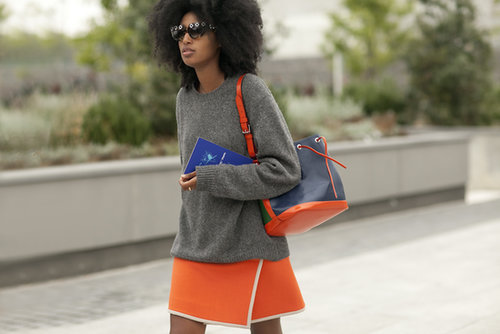 Julia Sarr Jamois kept it coordinated with all the right colors on her bucket bag and skirt.