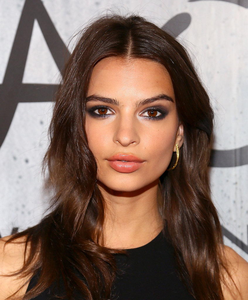 "Model and actress Emily Ratajkowski (of ""Blurred Lines"" fame) stepped out with a metallic smoky eye, which she paired with a glossy coral lip."