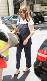 Alexa Chung rocked a pair of Topshop dungarees during an outing in London, then gave it a classic twist via cap-toe flats and a Louis Vuitton bag.